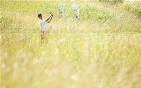 VERSAILLES, FRANCE - JUNE 26:  Mark Foster of England plays out of the rough on the 14th hole during the first round of the Open de France ALSTOM at the Le Golf National Golf Club on June 26, 2008 in Versailles, France.  (Photo by Warren Little/Getty Images)