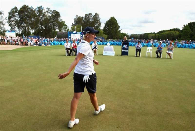 GOLD COAST, AUSTRALIA - MARCH 07:  Karrie Webb of Australia walks out onto the 18th green to accept her winners trophy after round four of the 2010 ANZ Ladies Masters at Royal Pines Resort on March 7, 2010 in Gold Coast, Australia.  (Photo by Ryan Pierse/Getty Images)