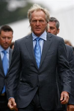 SAN FRANCISCO - OCTOBER 07:  International Team captain Greg Norman walks to the stage during the Opening Cermonies prior to the start of The Presidents Cup at Harding Park Golf Course on October 7, 2009 in San Francisco, California.  (Photo by Scott Halleran/Getty Images)