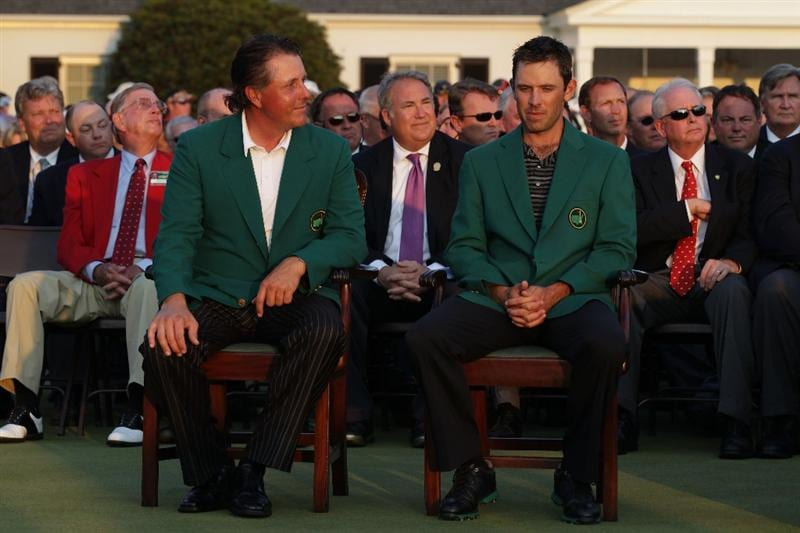 AUGUSTA, GA - APRIL 10:  Phil Mickelson (L) and Charl Schwartzel of South Africa (R) are seen at the green jacket presentation after Schwartzel's two-stroke victory at the 2011 Masters Tournament at Augusta National Golf Club on April 10, 2011 in Augusta, Georgia.  (Photo by David Cannon/Getty Images)