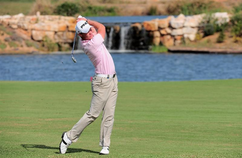 VILAMOURA, PORTUGAL - OCTOBER 18:  Danny Willett of England hits his second shot on the seventh hole during the final round of the Portugal Masters at the Oceanico Victoria Golf Course on October 18, 2009 in Vilamoura, Portugal.  (Photo by Stuart Franklin/Getty Images)