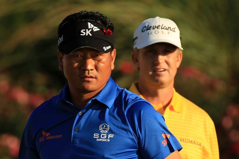 PONTE VEDRA BEACH, FL - MAY 15:  K.J. Choi of South Korea (L) and David Toms (R) look on from the 18th tee box during the final round of THE PLAYERS Championship held at THE PLAYERS Stadium course at TPC Sawgrass on May 15, 2011 in Ponte Vedra Beach, Florida.  (Photo by Streeter Lecka/Getty Images)