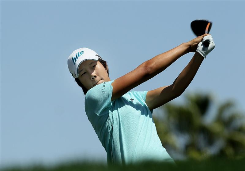 RANCHO MIRAGE, CA - APRIL 04:  Song-Hee Kim of South Korea hits her tee shot on the 11th hole during the final round of the Kraft Nabisco Championship at Mission Hills Country Club on April 4, 2010 in Rancho Mirage, California.  (Photo by Stephen Dunn/Getty Images)