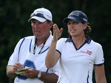 WEST PALM BEACH, FL - NOVEMBER 17:  Juli Inkster chats with her caddie Worth Blackwelder on the seventh tee during the third round of the 2007 ADT Championship at the Trump International Golf Club on November 17, 2007 in West Palm Beach, Florida  (Photo by Scott Halleran/Getty Images)