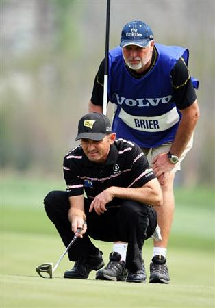 BEIJING - APRIL 17:  Markus Brier of Austria lines up a putt with his caddie during the round two of the Volvo China Open at the Beijing CBD International Golf Club on April 17, 2009 in Beijing, China.  (Photo by Guang Niu/Getty Images)