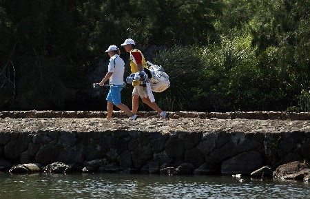 KAHUKU, HI - FEBRUARY 16:  Annika Sorenstam of Sweden and her caddie walk accross a bridge on the 11th hole during the final round of the SBS Open on February 16, 2008  at the Turtle Bay Resort in Kahuku, Hawaii.  (Photo by Andy Lyons/Getty Images)