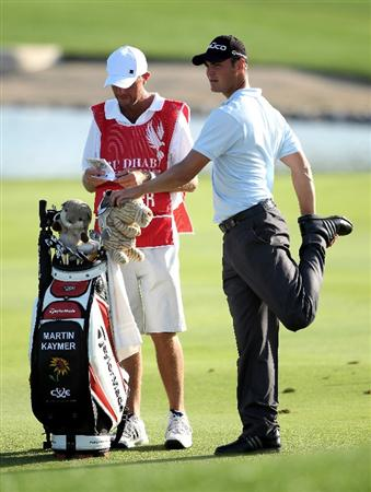 ABU DHABI, UNITED ARAB EMIRATES - JANUARY 24:  Martin Kaymer of Germanywaits with his caddie Justin Grenfell-Hoyle on the 17th hole during the final round of The Abu Dhabi Golf Championship at Abu Dhabi Golf Club on January 24, 2010 in Abu Dhabi, United Arab Emirates.  (Photo by Andrew Redington/Getty Images)