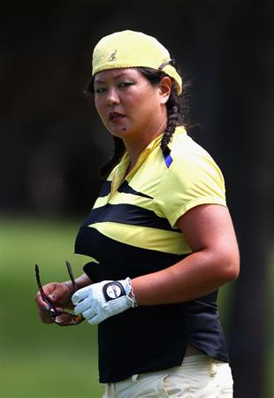 GOLD COAST, AUSTRALIA - MARCH 04:  Christina Kim of the USA walks down the 8th fairway during round one of the 2010 ANZ Ladies Masters at Royal Pines Resort on March 4, 2010 in Gold Coast, Australia.  (Photo by Ryan Pierse/Getty Images)