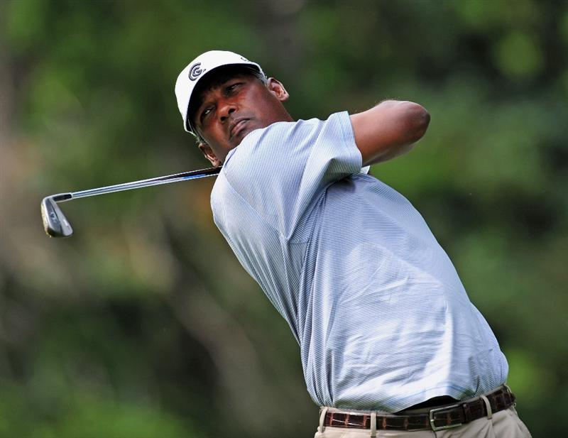 AKRON, OH - AUGUST 05:  Vijay Singh of Fiji plays his tee shot during a practice round of the World Golf Championship Bridgestone Invitational on August 5, 2009 at Firestone Country Club in Akron, Ohio.  (Photo by Stuart Franklin/Getty Images)