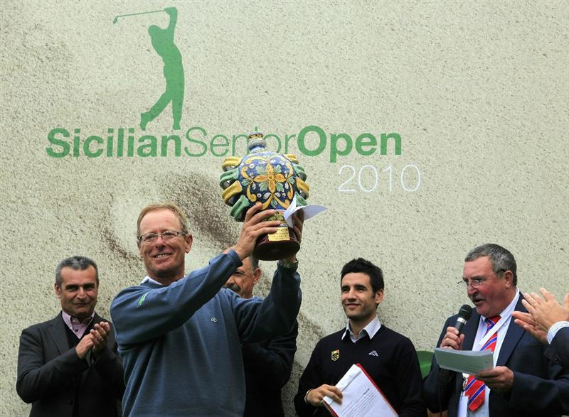 CATANIA, ITALY - OCTOBER 24:  Domingo Hospital of Spain poses with the trophy after winning the playoff to Horacio Carbonetti of Argentina during the final round of the Sicilian Senior Open played at Il Picciolo Golf Club on October 24, 2010 in Catania, Italy.  (Photo by Phil Inglis/Getty Images)