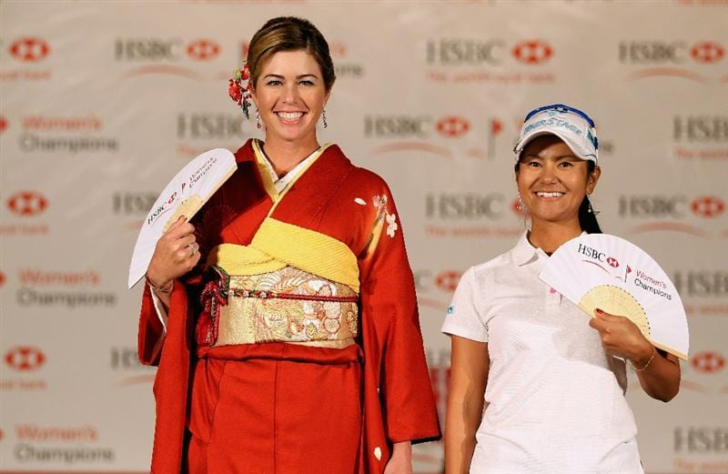 SINGAPORE - FEBRUARY 22:  Michelle Wie of the USA wears traditional Japaneseand dress alongside Ai Miyazato of Japan during a photocall at the Fairmont Hotel prior to the start of the HSBC Women's Champions at the Tanah Merah Country Club on February 22, 2011 in Singapore.  (Photo by Andrew Redington/Getty Images)
