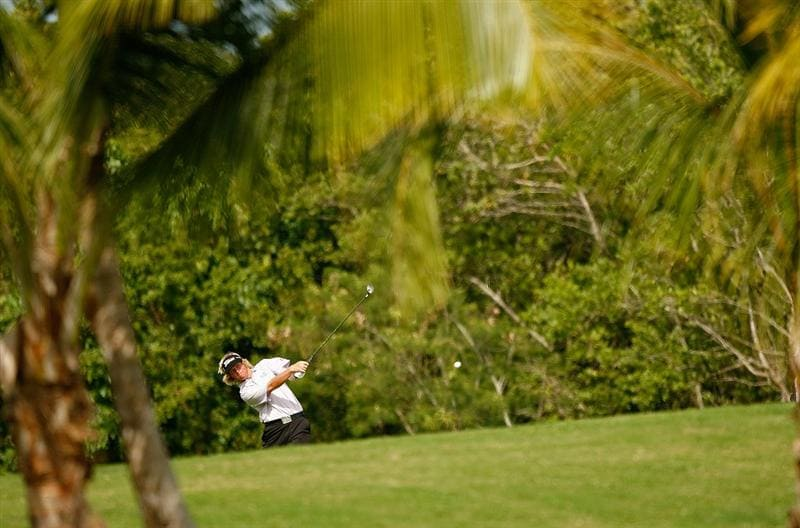 RIO GRANDE, PR - MARCH 12:  Derek Fathauer hits his approach shot on the 18th hole during the first round of the 2009 Puerto Rico Open presented by Banco Popular at the Trump International Golf Club in Rio Grande, Puerto Rico.  (Photo by Mike Ehrmann/Getty Images)