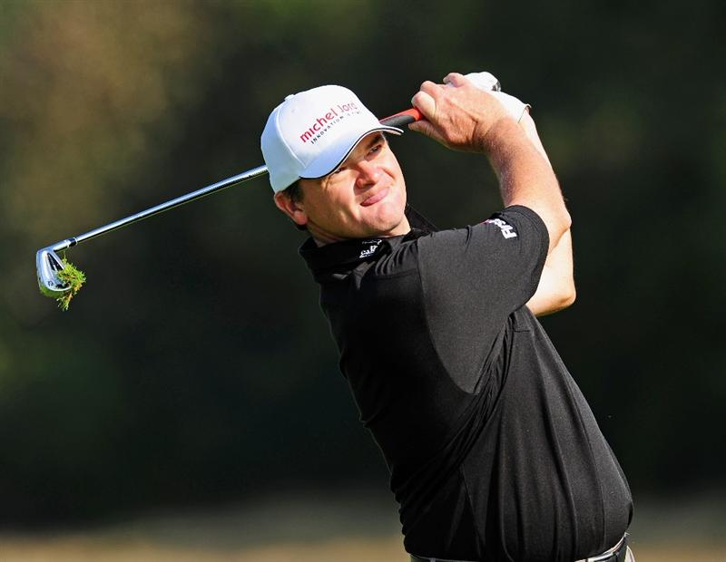 COLOGNE, GERMANY - SEPTEMBER 09:  Paul Lawrie of Scotland plays his approach shot during the pro - am prior to The Mercedes-Benz Championship at The Gut Larchenhof Golf Club on September 9, 2009 in Pulheim, near Cologne, Germany.  (Photo by Stuart Franklin/Getty Images)