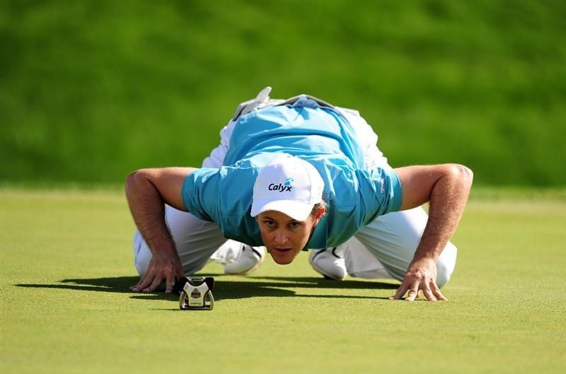 VILAMOURA, PORTUGAL - OCTOBER 18:  Stuart Manley of Wales lines up a putt during the third round of the Portugal Masters at the Oceanico Victoria Golf Course on October 18, 2008 in Vilamoura, Portugal.  (Photo by Richard Heathcote/Getty Images)