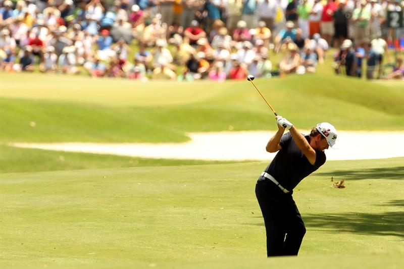PONTE VEDRA BEACH, FL - MAY 15:  Graeme McDowell of Northern Ireland hits an approach shot on the second hole during the final round of THE PLAYERS Championship held at THE PLAYERS Stadium course at TPC Sawgrass on May 15, 2011 in Ponte Vedra Beach, Florida.  (Photo by Mike Ehrmann/Getty Images)
