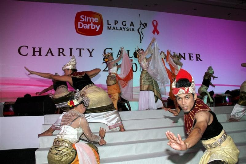 KUALA LUMPUR, MALAYSIA - OCTOBER 22 : Malaysia Traditional Dancers perform during the Sime Darby LPGA Charity Gala Dinner on October 22, 2010 at the Sime Darby Convention Centre in Kuala Lumpur, Malaysia. (Photo by Stanley Chou/Getty Images)