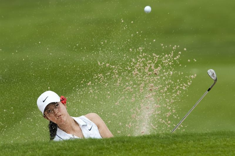 CHON BURI, THAILAND - FEBRUARY 17:  Michelle Wie of USA plays a shot on the 3rd hole during day one of the LPGA Thailand at Siam Country Club on February 17, 2011 in Chon Buri, Thailand.  (Photo by Victor Fraile/Getty Images)