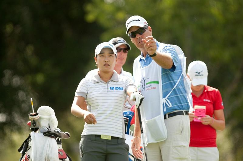 DANVILLE, CA - OCTOBER 16: Ilhee Lee of South Korea and caddie John Brown discuss a tee shot during the third round of the CVS/Pharmacy LPGA Challenge at Blackhawk Country Club on October 16, 2010 in Danville, California. (Photo by Darren Carroll/Getty Images)