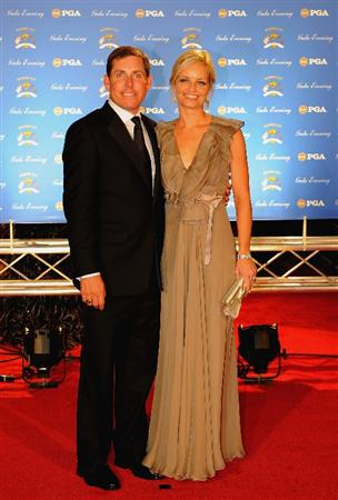 LOUISVILLE, KY - SEPTEMBER 17:  Justin Leonard of the USA team and wife Amanda arrive on the red carpet for the Ryder Cup Gala dinner prior to the start of the 2008 Ryder Cup September 17, 2008 in Louisville, Kentucky.  (Photo by Sam Greenwood/Getty Images)
