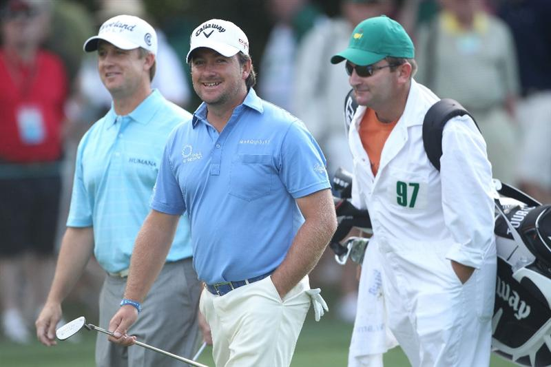 AUGUSTA, GA - APRIL 08:  Graeme McDowell of Northern Ireland (C) walks alongside his caddie Ken Comboy and David Toms on the first hole during the first round of the 2010 Masters Tournament at Augusta National Golf Club on April 8, 2010 in Augusta, Georgia.  (Photo by Andrew Redington/Getty Images)