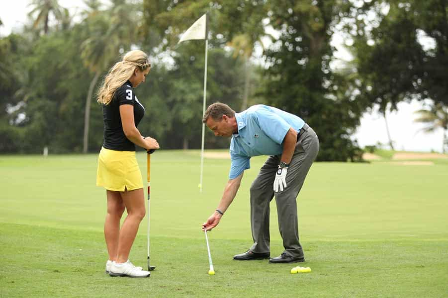 Michael Breed setting up a drill for Meghan Hardin