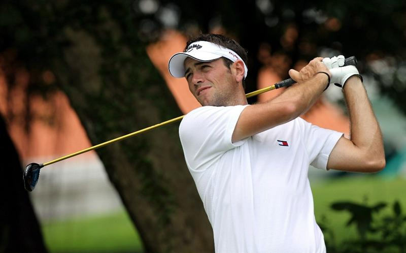 SINGAPORE, NOVEMBER 12 : Nick Dougherty of England hits a tee shot on the 8th hole during the second round of the Barclays Singapore Open held at the Sentosa Golf Club on November 12, 2010 Singapore. (Photo by Stanley Chou/Getty Images)