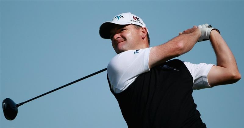 DOHA, QATAR - FEBRUARY 04:  Paul Lawrie of Scotland hits his tee-shot on the 18th hole during the second round of the Commercialbank Qatar Masters held at Doha Golf Club on February 4, 2011 in Doha, Qatar.  (Photo by Andrew Redington/Getty Images)