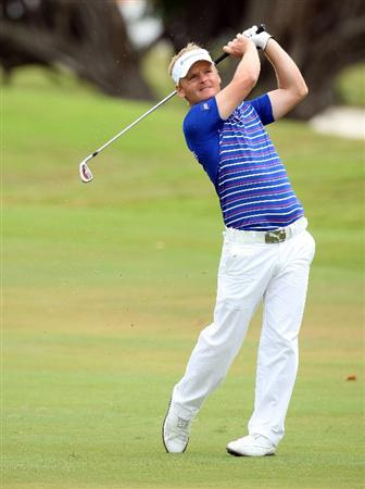 DORAL, FL - MARCH 13:  Soren Kjeldsen of Denmark plays his second shot at the 1st hole during the second round of the World Golf Championships-CA Championship at the Doral Golf Resort & Spa on March 13, 2009 in Miami, Florida  (Photo by David Cannon/Getty Images)