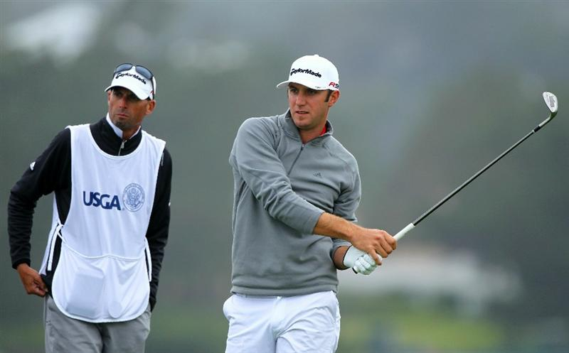 PEBBLE BEACH, CA - JUNE 18:  Dustin Johnson watches his tee shot on the seventh hole with his caddie Bobby Brown during the second round of the 110th U.S. Open at Pebble Beach Golf Links on June 18, 2010 in Pebble Beach, California.  (Photo by Donald Miralle/Getty Images)