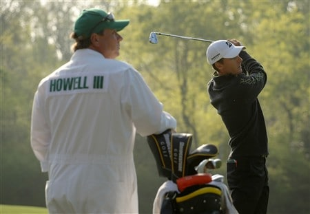 AUGUSTA, GA - APRIL 09:  Charles Howell III hits a shot as his caddie Jimmy Johnson looks on during the third day of practice prior to the start of the 2008 Masters Tournament at Augusta National Golf Club on April 9, 2008 in Augusta, Georgia.  (Photo by Harry How/Getty Images)