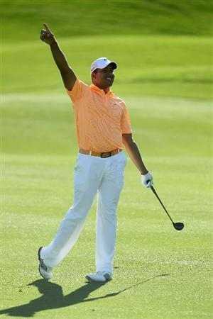 LA QUINTA, CA - JANUARY 23:  Jhonattan Vegas of Venezuela gestures right after hitting his second shot from the 11th fairway during the final round of the Bob Hope Classic at the Palmer Private course at PGA West on January 23, 2011 in La Quinta, California.  (Photo by Jeff Gross/Getty Images)