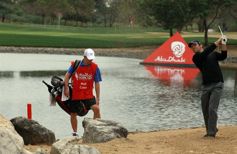 ABU DHABI, UNITED ARAB EMIRATES - JANUARY 21:  Paul Casey of England plays his second shot on the 9th hole during the second round of the 2011 Abu Dhabi HSBC Golf Championship held at the Abu Dhabi Golf Club on January 21, 2011 in Abu Dhabi, United Arab Emirates.  (Photo by David Cannon/Getty Images)