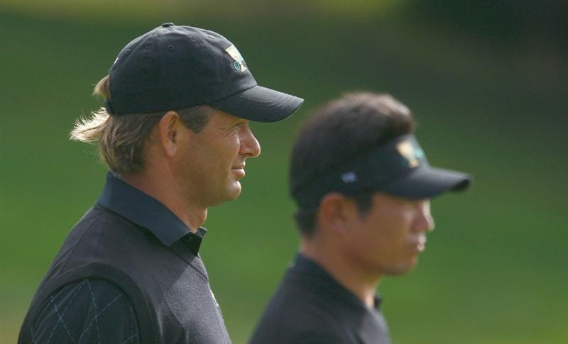SAN FRANCISCO - OCTOBER 08:  Retief Goosen and Y.E. Yang of the International Team walks down the 13th fairway during the Day One Foursome Matches of The Presidents Cup at Harding Park Golf Course on October 8, 2009 in San Francisco, California.  (Photo by Scott Halleran/Getty Images)