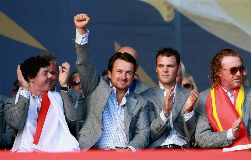 NEWPORT, WALES - OCTOBER 04:  Graeme McDowell of Europe waves to the crowds at the closing cermonies as Rory McIlroym Martin Kaymer and Miguel Angel Jimenez look on following Europe's 14.5 to 13.5 victory over the USA at the 2010 Ryder Cup at the Celtic Manor Resort on October 4, 2010 in Newport, Wales.  (Photo by Andrew Redington/Getty Images)