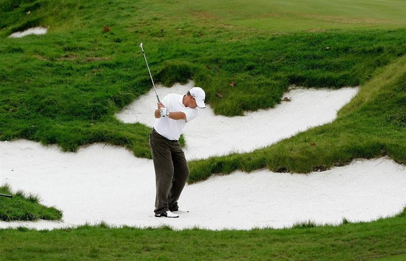 INCHEON, SOUTH KOREA - SEPTEMBER 10:  John Cook of United States out of a bunker on the first hole during day one of PGA Champions Tour - Posco E&C Songdo Championship at Jack Nicklaus Golf Club on September 10, 2010 in Incheon, South Korea.  (Photo by Chung Sung-Jun/Getty Images)