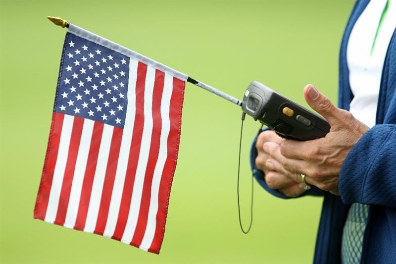 LEMONT, IL - SEPTEMBER 11:  A scoring volunteer holds an American flag as she walks the course during the third round of the BMW Championship at Cog Hill Golf & Country Club on September 11, 2010 in Lemont, Illinois.  (Photo by Scott Halleran/Getty Images)