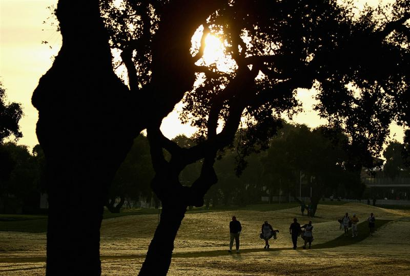 SOTOGRANDE, SPAIN - OCTOBER 28:  A group of players walk off the first tee in the early morning light during the first round of the Andalucia Valderrama Masters at Club de Golf Valderrama on October 28, 2010 in Sotogrande, Spain.  (Photo by Richard Heathcote/Getty Images)
