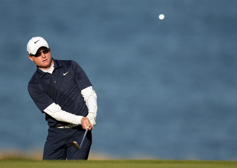 KINGSBARNS, SCOTLAND - OCTOBER 07:  Simon Dyson of England chips onto the 18th green during the first round of The Alfred Dunhill Links Championship at Kingsbarns Golf Links on October 7, 2010 in Kingsbarns, Scotland.  (Photo by Ross Kinnaird/Getty Images)