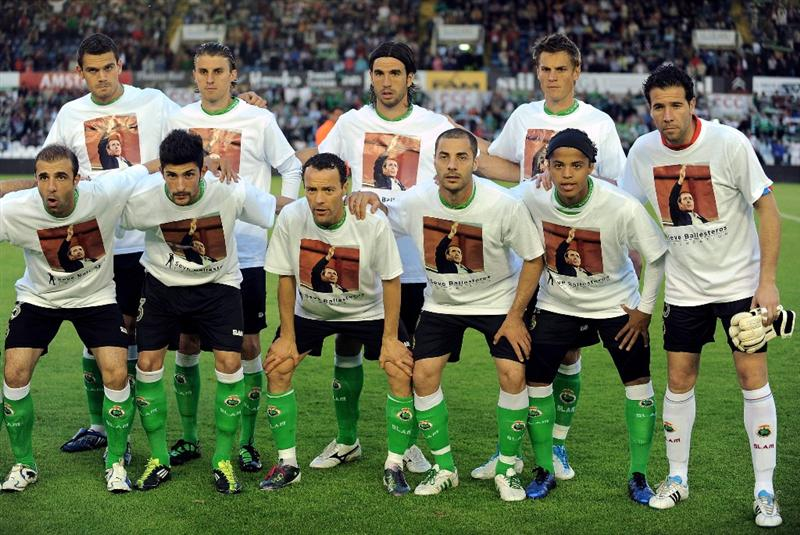 SANTANDER, SPAIN - MAY 10: Racing Santander line up showing with photographs of the late Spanish golfing legend Seve Ballesteros before the La Liga match between Racing Santander and Atletico Madrid on May 10, 2011 in El Sardinero stadium in Santander near Ballesteros' home village of Pedrena, in Spain.  The funeral for the legendary Spanish golfer, who died at the age of 54 following a lengthy battle with cancer,  will be held tommorow in his home village of  Pedrena.  (Photo by Denis Doyle/Getty Images)