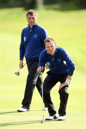 DUMBARTON, SCOTLAND - SEPTEMBER 18:  Jamie Harris of England (R) and Paul Simpson of England and of the Great Britain and Ireland Team look on at the 9th hole during the afternoon fourball matches at The Carrick on Loch Lomond on September 19, 2009 in Dumbarton, Scotland.  (Photo by David Cannon/Getty Images)