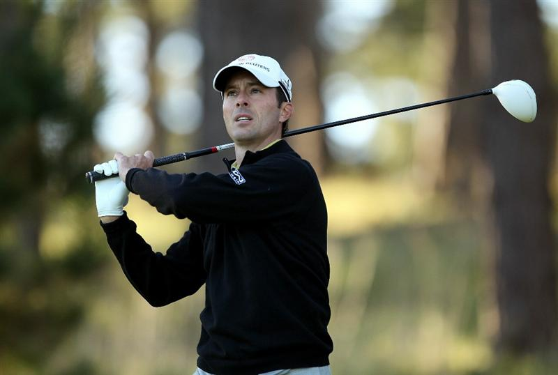 PEBBLE BEACH, CA - FEBRUARY 10:  Mike Weir of Canada tees off on the 11th hole at the Spyglass Hill Golf Course during Round One of the AT&T Pebble Beach National Pro-Am on February 10, 2011 in Pebble Beach, California.  (Photo by Ezra Shaw/Getty Images)