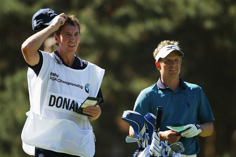 VIRGINIA WATER, ENGLAND - MAY 22:  Luke Donald of England takes advice from his caddie John McLaren before he tees off at the 8th hole during the third round of the BMW PGA Championship on the West Course at Wentworth on May 22, 2010 in Virginia Water, England.  (Photo by Ross Kinnaird/Getty Images)