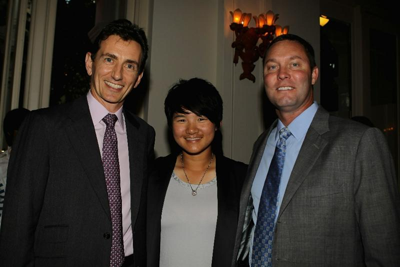 SINGAPORE - FEBRUARY 23:  (L-R) Alex Hungate, CEO of HSBC Singapore; Yani Tseng of Taiwan and Michael Whan, LPGA Commissioner pose for a photograph during the Welcome Reception prior to the start of the HSBC Women's Champions at the Tanah Merah Country Club on February 23, 2011 in Singapore.  (Photo by Scott Halleran/Getty Images)