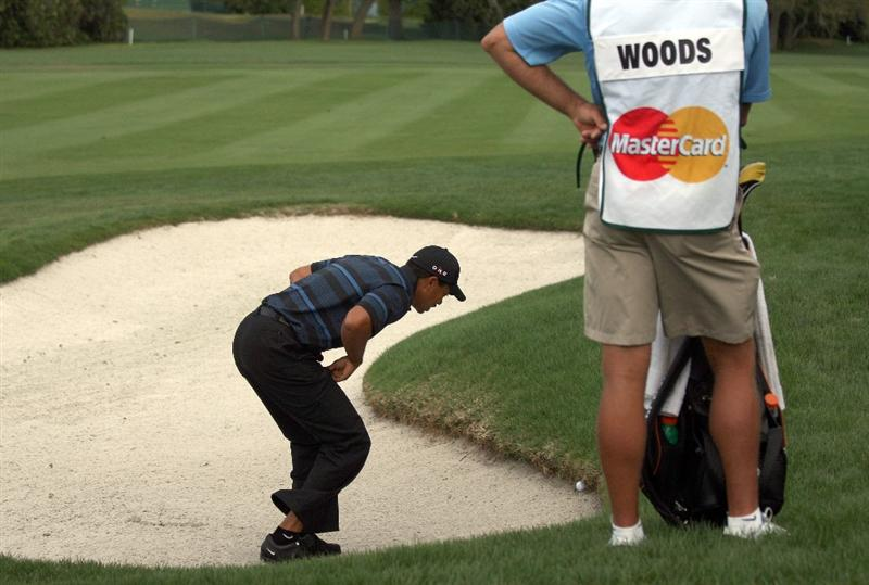 ORLANDO, FL - MARCH 27:  Tiger Woods of the USA finds a really poor lie in a fairway bunker for his second shot on the 1st hole during the second round of the Arnold Palmer Invitational Presented by Mastercard at the Bay Hill Club and Lodge on March 27, 2009 in Orlando, Florida  (Photo by David Cannon/Getty Images)