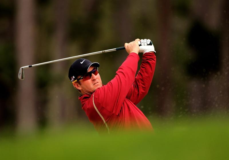 PEBBLE BEACH, CA - FEBRUARY 11:  David Duval hits his second shot on the ninth hole during the first round of the AT&T Pebble Beach National Pro-Am at at the Spyglass Hill Golf Course on February 11, 2010 in Pebble Beach, California.  (Photo by Ezra Shaw/Getty Images)