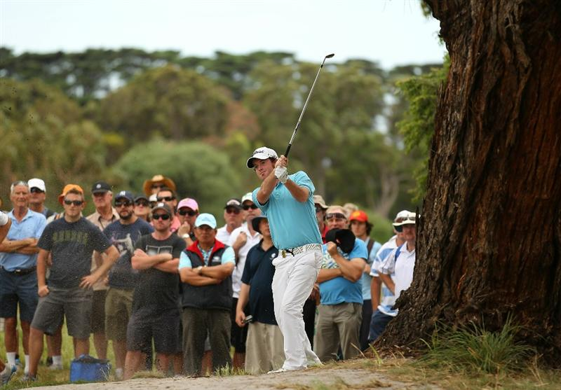 MELBOURNE, AUSTRALIA - NOVEMBER 12: Josh Geary of Australia hits out of the rough during round two of the Australian Masters at The Victoria Golf Club on November 12, 2010 in Melbourne, Australia.  (Photo by Robert Cianflone/Getty Images)