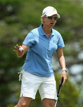 SINGAPORE - FEBRUARY 27:  Karrie Webb of Australia waves to the crowd on the 17th hole during the final round of the HSBC Women's Champions at the Tanah Merah Country Club on February 27, 2011 in Singapore.  (Photo by Andrew Redington/Getty Images)