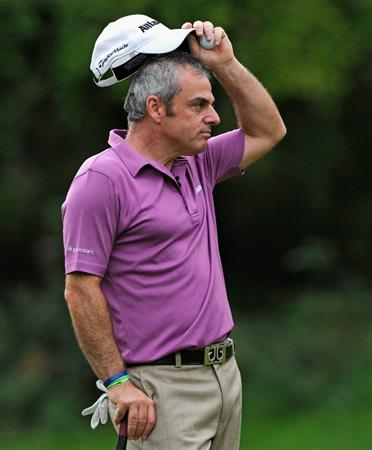 PARIS - SEPTEMBER 23: Paul McGinley of Ireland ponders during the first round of the Vivendi cup at Golf de Joyenval on September 22, 2010 in Chambourcy, near Paris, France.  (Photo by Stuart Franklin/Getty Images)
