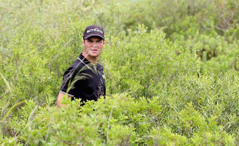 CASARES, SPAIN - MAY 19:  Martin Kaymer of Germany in the bushes on the 5th hole during the group stages of the Volvo World Match Play Championship at Finca Cortesin on May 19, 2011 in Casares, Spain.  (Photo by Ross Kinnaird/Getty Images)