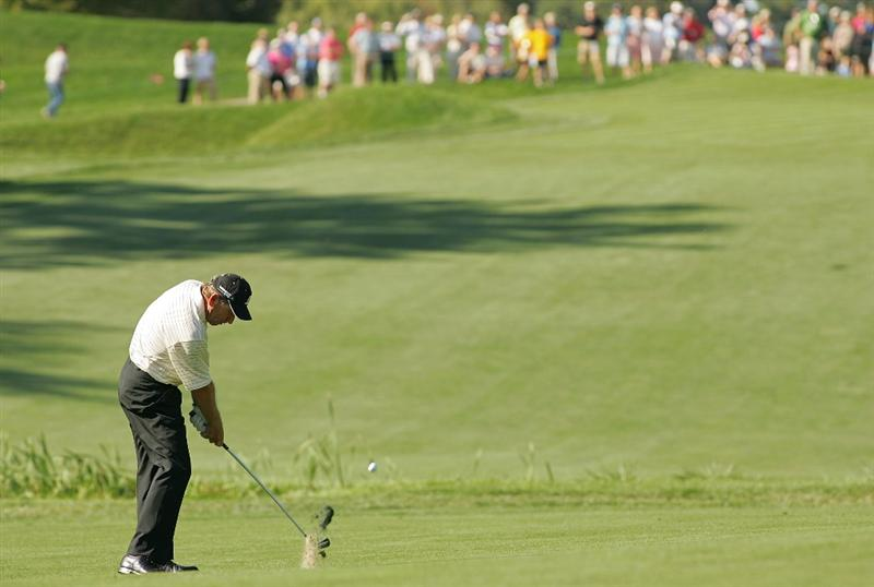 TIMONIUM, MD - OCTOBER 12: Nick Price hits his second shot on the ninth hole during the final round of the Constellation Energy Senior Players Championship at Baltimore Country Club East Course held on October 12, 2008 in Timonium, Maryland (Photo by Michael Cohen/Getty Images)